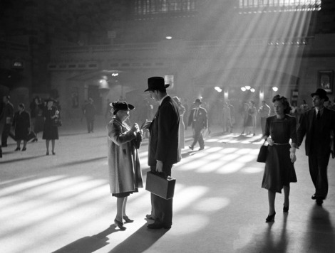 A man and woman talk together as people pass through the Main Concourse of New York's Grand Central Terminal in Midtown Manhattan, in October of 1941