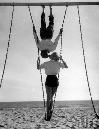 Allan Grant swingers 1955 Acrobat and actor, Russ Tamblyn (Top) on the beach with movie actress Venetia Stevenson