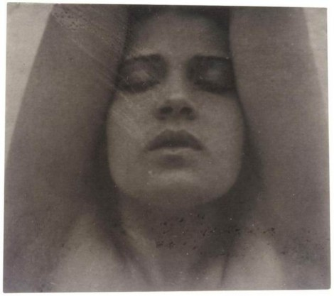 Tina Modotti with her arms raised -Edward Weston